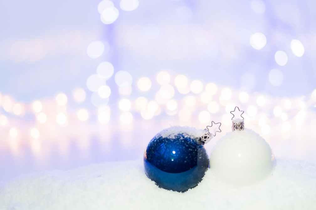 blue round christmas ornament on snow